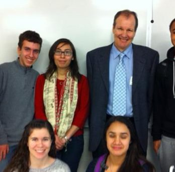 Munoz and Ireland with a mixed group of high school students
