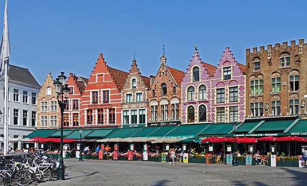 A plaza in Belgium with traditional buildings.