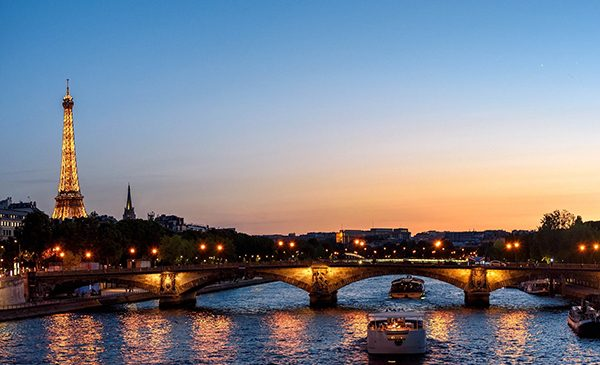 The Eiffel Tower and the Seine River at sunset