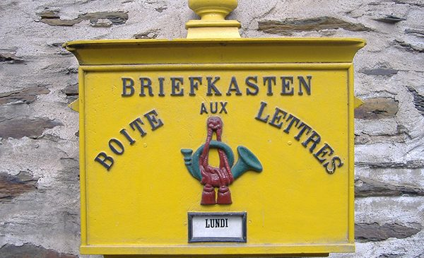 A yellow mailbox in Luxembourg that reads